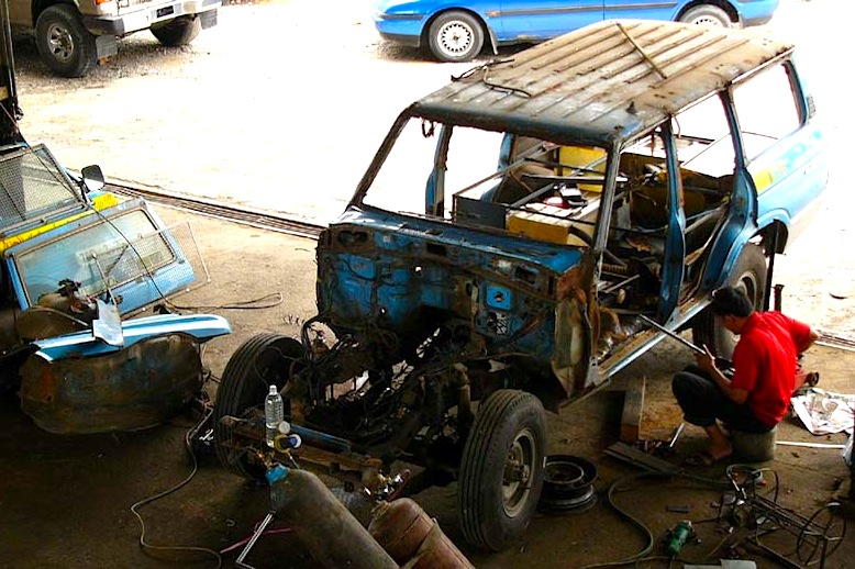 A photo of the Schmids car being repaired