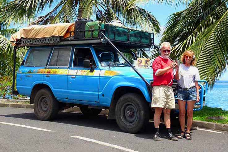 A photo of the Schmid's with their Toyota Land Cruiser